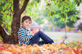 Little toddler boy, eating apple in the afternoon Royalty Free Stock Photo