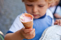 Little toddler boy eating ice cream in cone Stock Photography
