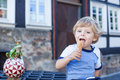 Little toddler boy eating ice cream in cone Royalty Free Stock Photo