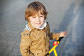 Little toddler boy having fun and riding his bike portrait of preschool in the city Stock Image
