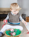 Little toddler boy playing with self made Easter eggs Stock Images