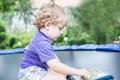 Little toddler boy playing with tablet pc outdoors Royalty Free Stock Photo