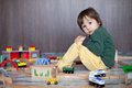 Little toddler boy playing with wooden railway indoors Stock Photography