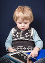 Little toddler boy two years playing tablet pc Stock Photos