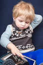 Little toddler boy two years playing tablet pc Royalty Free Stock Photography