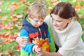 Little toddler boy and young mother in the autumn park Royalty Free Stock Image
