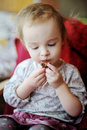 Little toddler girl eating chocolate Royalty Free Stock Photo