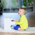 Little toddler girl plays toy piano Royalty Free Stock Photo