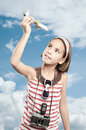 Little tourist girl holding airplane Royalty Free Stock Photography