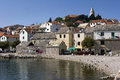 Little touristic town primosten on dalmatian coast in croatia seagulls the beach front of old houses Stock Photo