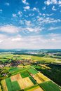 Little towns and villages with green fields during the sunny day