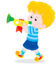 Little trumpeter boy blowing a small trumpet Royalty Free Stock Photos