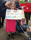 Little turkish girl in a demo is holding sign during demonstration hyde park london supporting the protesters istanbul following Royalty Free Stock Photography