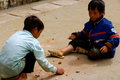 Little Vietnamese boys playing games on the path Royalty Free Stock Photo