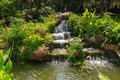 Little water fall over rocks in garden Royalty Free Stock Image