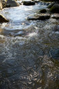 Little waters with rocks Royalty Free Stock Image