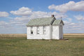 Little white church on the prairies a prairie landscape with blue skies and clouds Royalty Free Stock Images