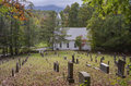 A little white church resided in the appalachian mountains country sits valley close to graveyard Stock Photography