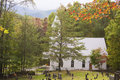 A little white church resided in the appalachian mountains country sits valley close to graveyard Royalty Free Stock Photos