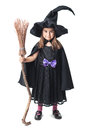 Little witch with a broom on white background Stock Photos