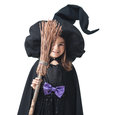 Little witch hiding behind broom on a white background Stock Photo