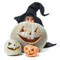 Little witch hiding behind pumpkins fun Royalty Free Stock Images