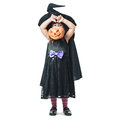 Little witch shows the collected candy in pumpkin Royalty Free Stock Photos