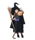 Little witch shows the collected candy in pumpkin Royalty Free Stock Images