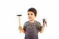 Little worker holding tools child Royalty Free Stock Photo