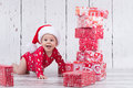 Little x-mas baby with gift tower Royalty Free Stock Photo