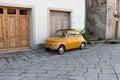 Little yellow compact Italian car Royalty Free Stock Photo