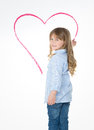Little young child drawing big heart Royalty Free Stock Photo