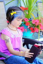Little yuppie girl reading bible Stock Photo