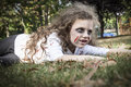 Little zombie girl a is dressed as a with scary makeup blood stained clothing and messy hair Stock Photos