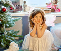 Littlle girl dreaming near Christmas tree Stock Photography