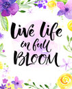 Live life in full of bloom. Inspirational saying, hand lettering card with warm wishes. Watercolor flowers and brush