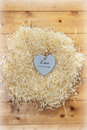 Live love laugh heart single wooden in a nest made of straw on floor boards Royalty Free Stock Images