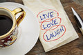 Live love laugh motivational words a napkin doodle with a cup of espresso coffee Royalty Free Stock Photography