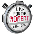 Live for the moment words stopwatch timer saying quote on a or to illustrate a motto or phrase about importance of enjoying Royalty Free Stock Photos