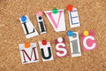 Live music the words in cut out magazine letters pinned to a cork notice board Stock Photo