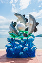Lively fish and pearl statue on the shore, Thailand. Royalty Free Stock Photo