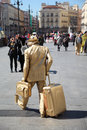 Lively sculpture golden man with big bag at street madrid march on march in madrid spain in number of tourists in resorts of spain Stock Images