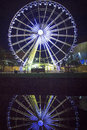 Liverpool big wheel the and reflection by night at albert dock the major unesco designated tourist attraction in Stock Photography