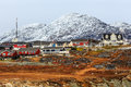 Living Inuit houses among the rocks and  mountain in the backgro Royalty Free Stock Photo