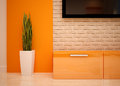 Living room detail interior design modern bright orange shades Stock Image