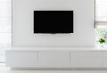 Living room detail tv on wall white with commode and epoxy flooring Stock Image