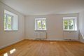 Living room in an old building - Apartment with wooden windows and parquet flooring after renovation Royalty Free Stock Photo