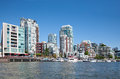 Living in vancouver false creek a short inlet the heart of british columbia canada is bordered by tall luxurious condo buildings Royalty Free Stock Image
