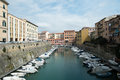 Livorno town italy canals and boats in the historic center of the city of region of tuscany Royalty Free Stock Image
