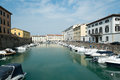 Livorno town italy canals and boats in the historic center of the city of region of tuscany Stock Image